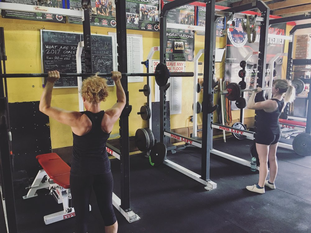 women female overhead pressing barbell gym - el segundo game time strength los angeles personal training group training team strength coach.JPG