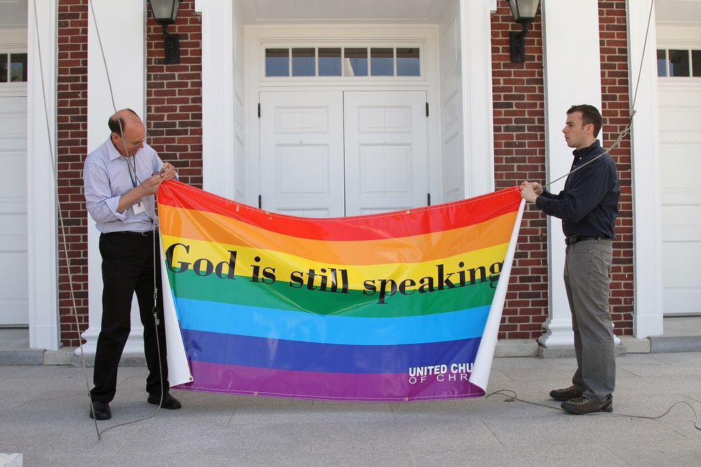 "Raising the Rainbow Banner after voting to become an ""Open and Affirming Congregation."""