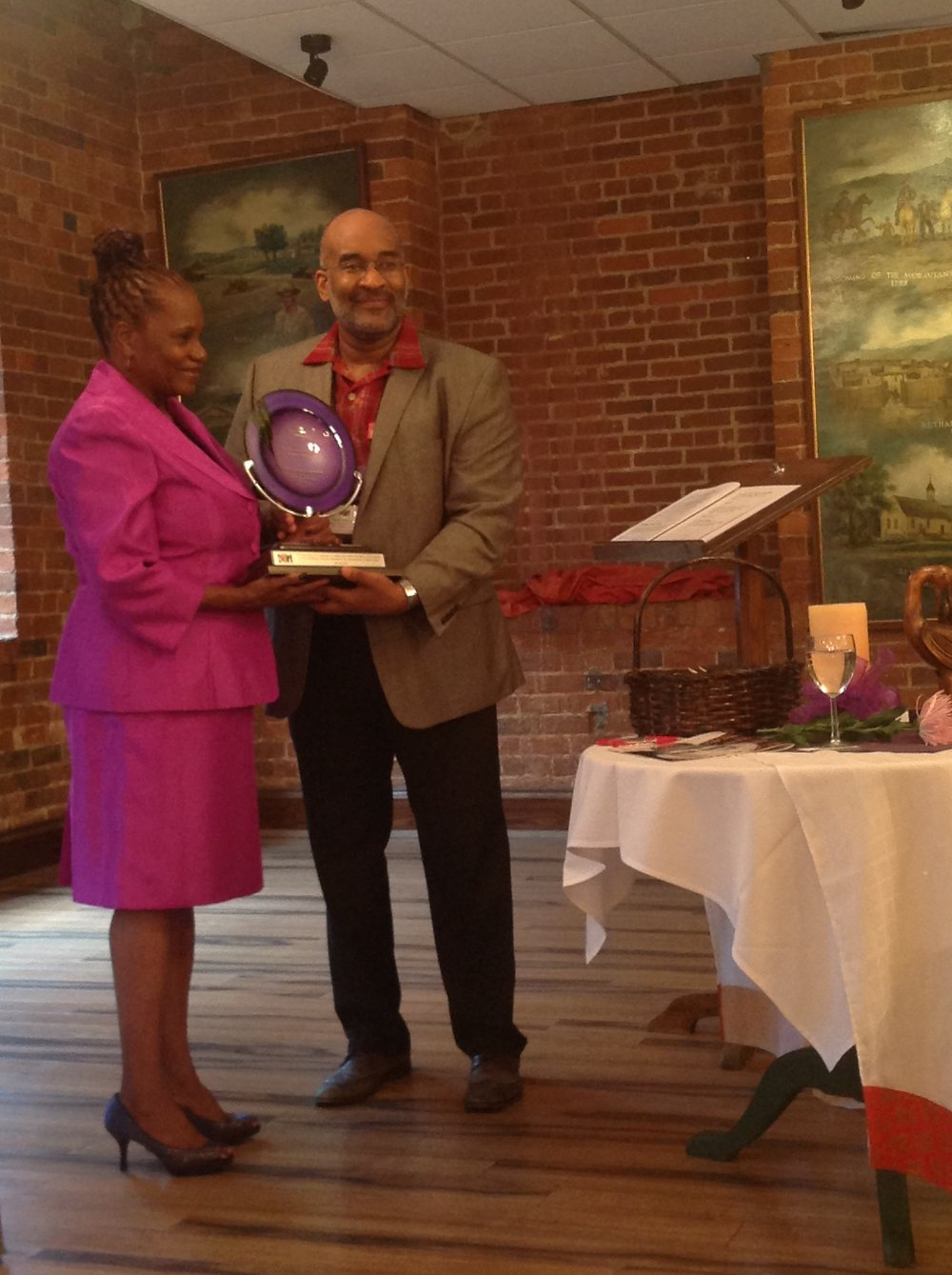 Sylvia Sprinkle-Hamlin with past President Michael Dinwiddie, receiving the inaugural award in 2013.