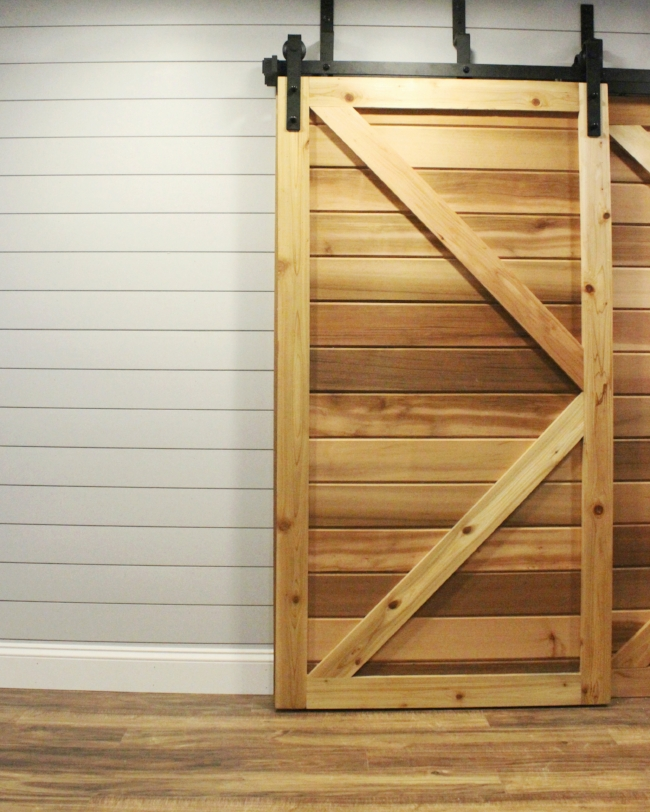 shiplap wall & DIY sliding barn door | rustic modern basement renovation