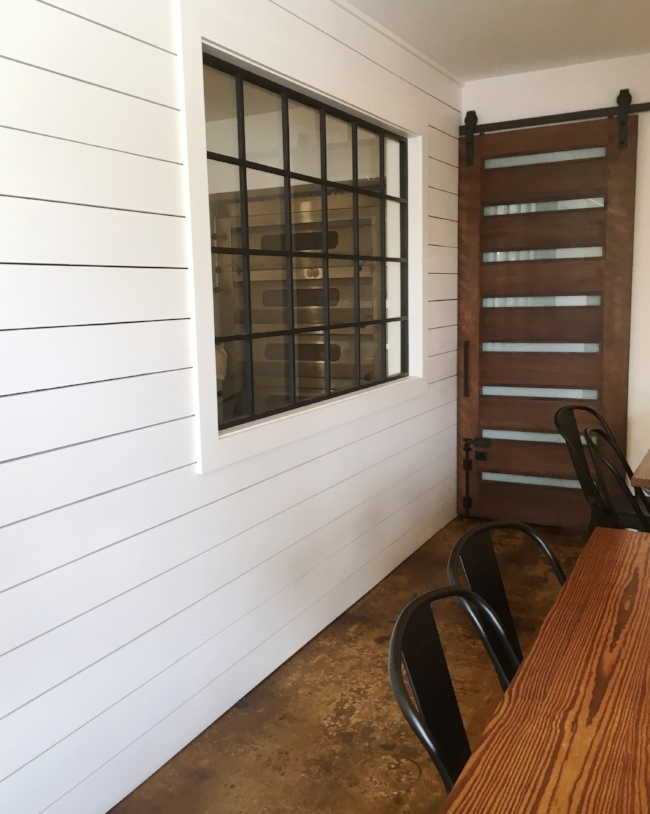 shiplap walls & barn sliding door | rustic modern decor at Buttermilk Handcrafted food in Sarasota, FL