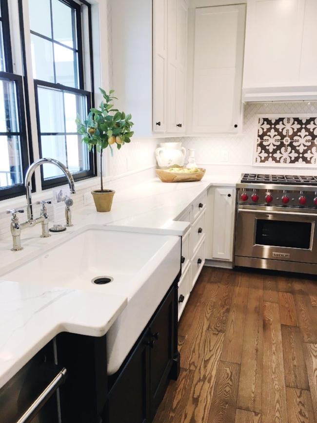 modern kitchen with farmhouse sink & patterned tile at madison parade of homes