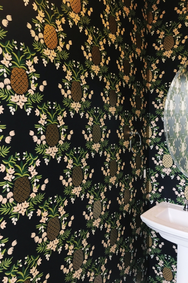 rifle paper co wallpaper in a powder room