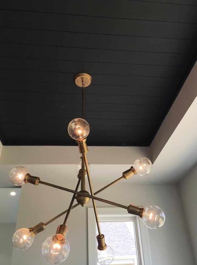 mid century modern sputnik light & black shiplap ceiling