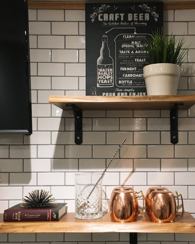 styling exposed bar shelving with subway tile and copper moscow mule mugs