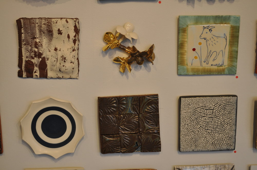 1 . Julie Buyon,  Emergence 2  $30  2. Christina Pitsch,  Untitled (Flora )  $400  3.  Eve Behar,  Goat Tile  (SOLD)  4.  Debra Holiber,  Tile 3  $55  5.  Myra Bowie,  Tic Tac Tile #2  $45  6.  Richard Burkett,  Wave  (SOLD)