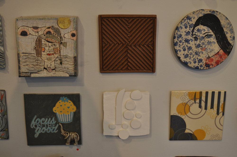 1.  Sheryl Zacharia,  Beach Girl  $200  2.  David MacDonald,  Carved Stoneware Tile 1  $50  3.  Eva Kwong,  Wall Flower 2  $200  4.  Sally Ng,  Focus on the Good  (SOLD)  5.  Lisa Breznak,  A Way Around It  $85  6 . Meredith Host,  Dot Dot Flora Tile  $60