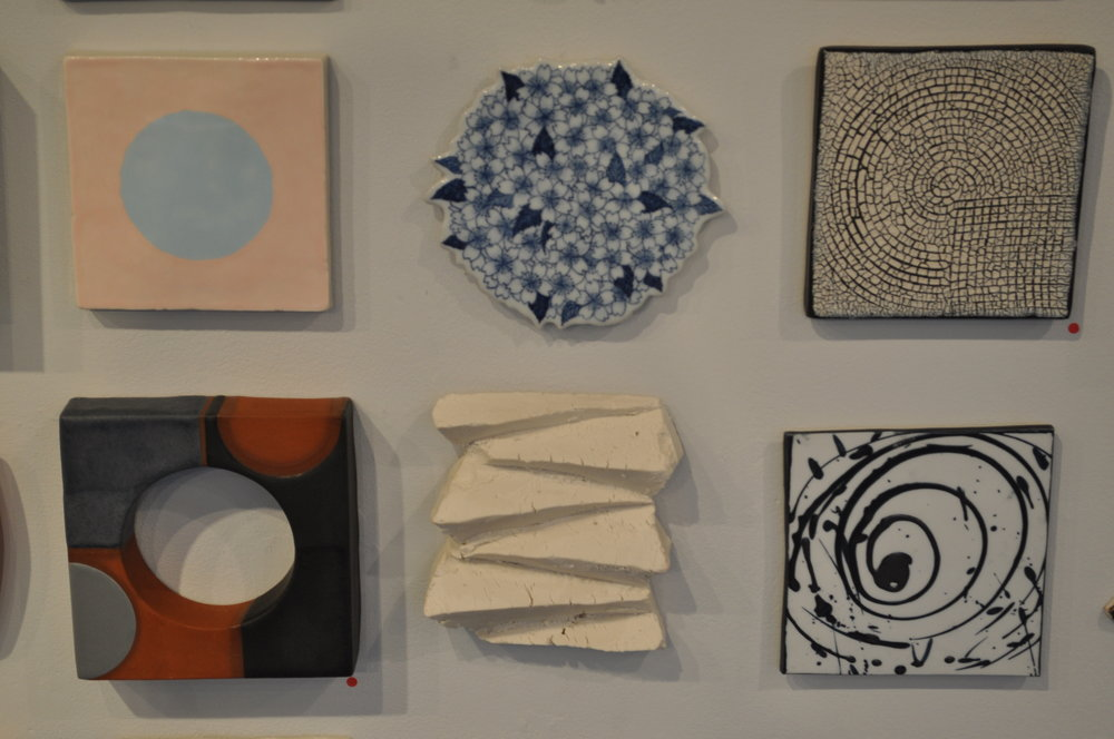 1.  Ron Geibel,  Blue on Pink  $150  2 . Hatsumi Suyama,  Flower tile 3  $80  3 . Richard Burkett,  Circle/square  (SOLD)  4.  Logan Wall,  Wall Tile #2  (SOLD)  5.  Clementine Porcelain,  Cut 6x5 (Jesse Ross) $100   6.  Reena Kashyap,  Splashed Circle  $50