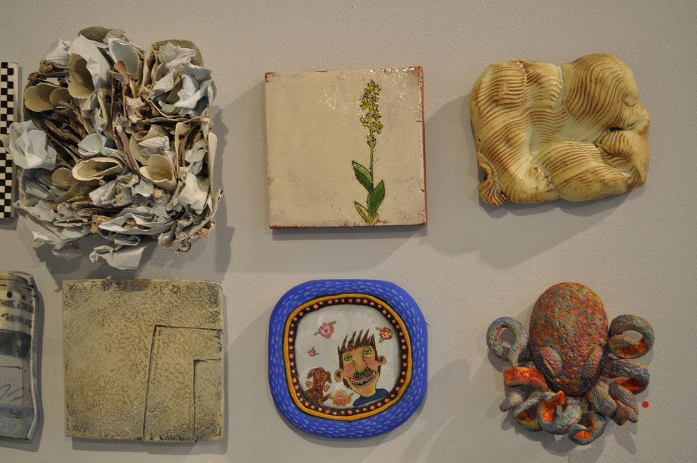 1.  Rebecca Hutchinson,  Tile 1  $225  2.  Ursula Hargens,  Small Tile (Bog Adder's Mouth)  $100  3.  Robin Henschel,  Geography  $85  4.  Mary Barringer,  Tile/plate  $100  5.  Jane Cohen,  Ahhhh…..Spring (square blue frame)  $85  6.  Mary Cloonan,  Octopi I  (SOLD)