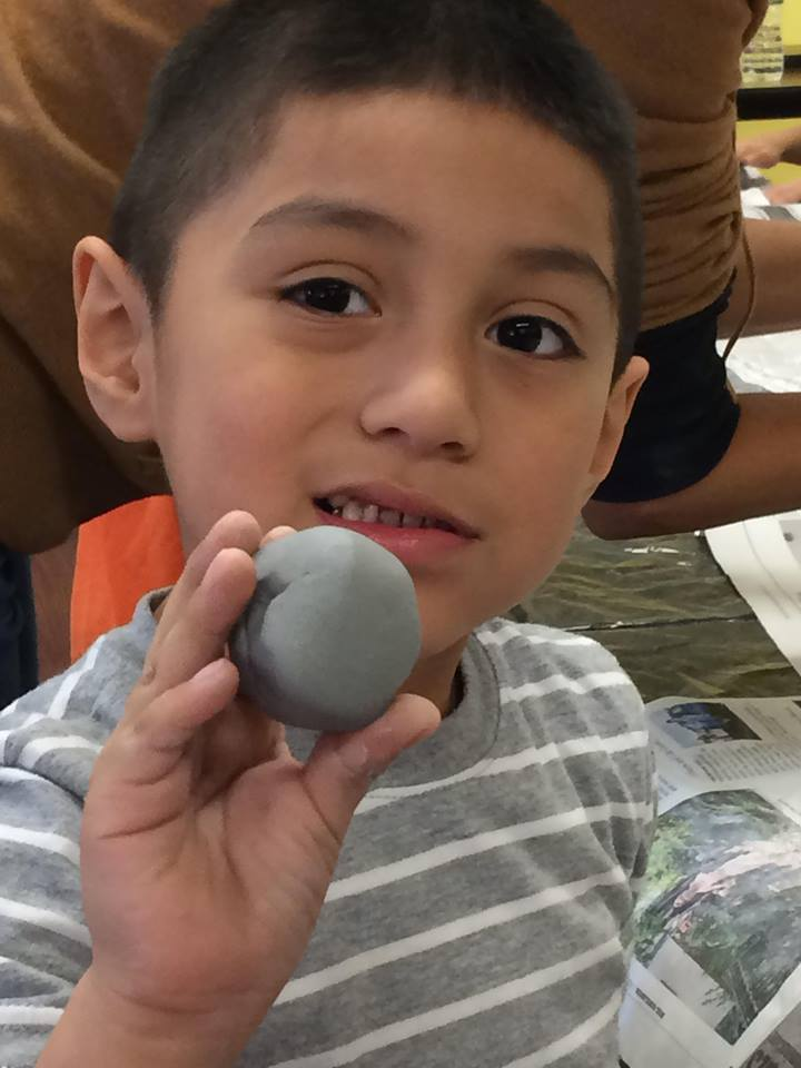 Boy holding ball of clay 2.jpg