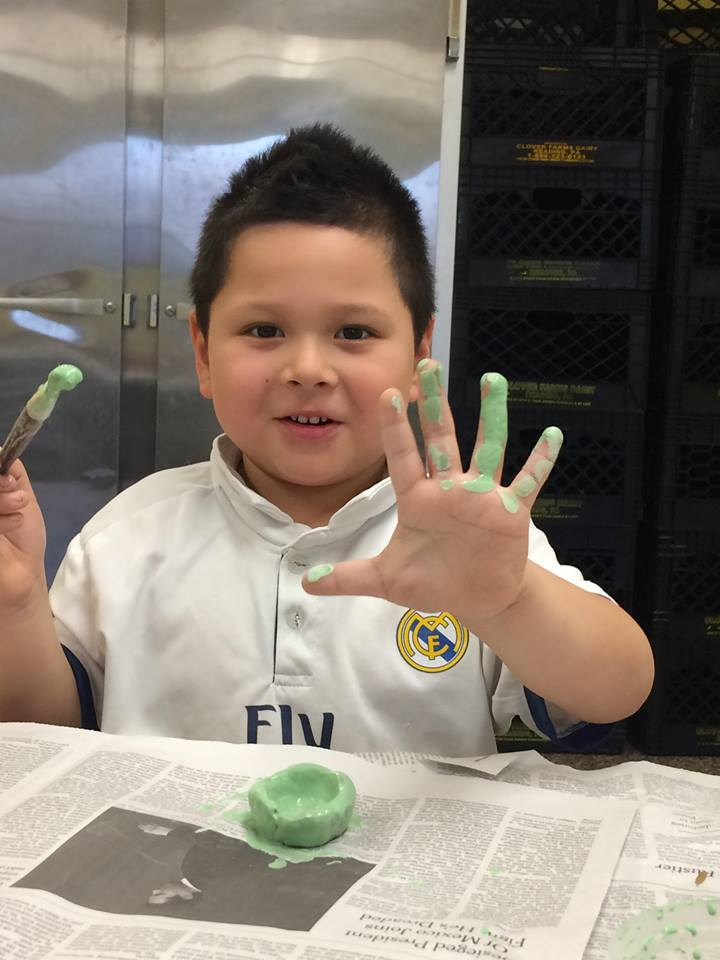 Boy with Green Glaze Hands.jpg