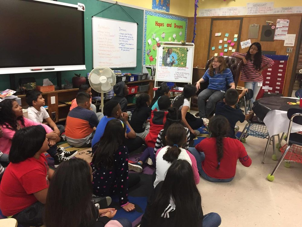 Instructor Alex Fitz Gerald discusses mosaic project with 5th graders at JFK Elmjpg.jpg