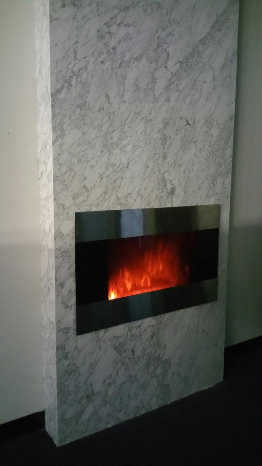 Carrara. Fireplace.JPG