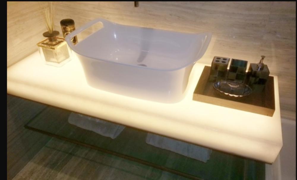 backlit white crystal glass vanity.png