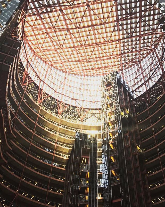 Thompson Center. It's the weirdest indoor public space I've been in. I am glad the city is selling it instead of demolishing this one. Train station, driving license office, shopping mall, food court, all rolled into one. It's probably the weirdest postmodernist (?) building in Chicago.