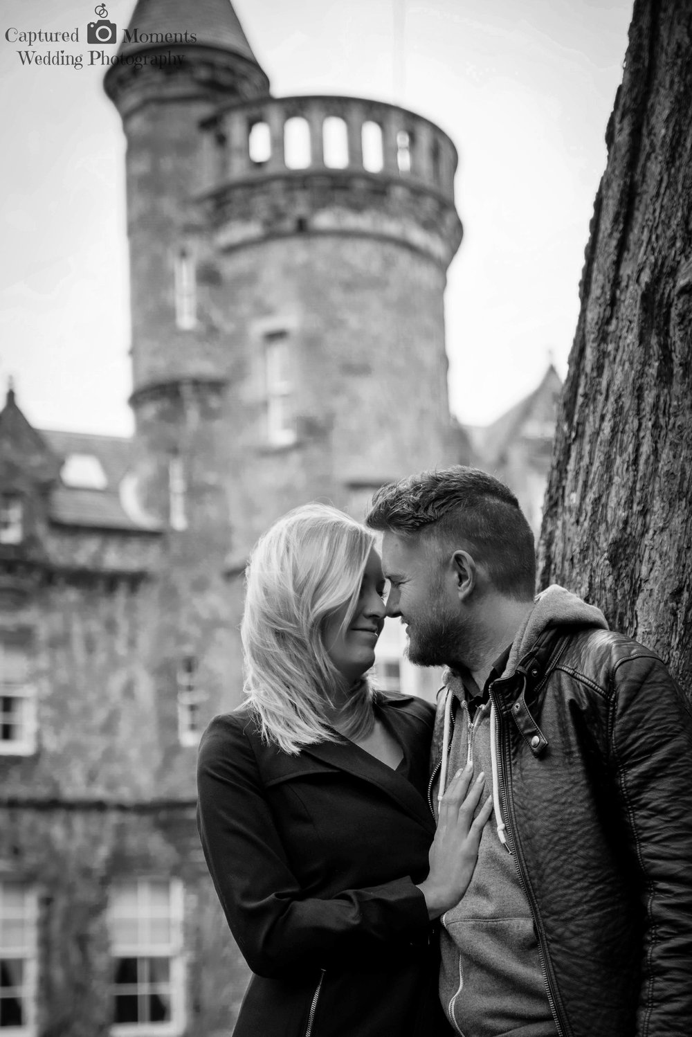 carlowrie castle with engaged couple on pre wedding shoot
