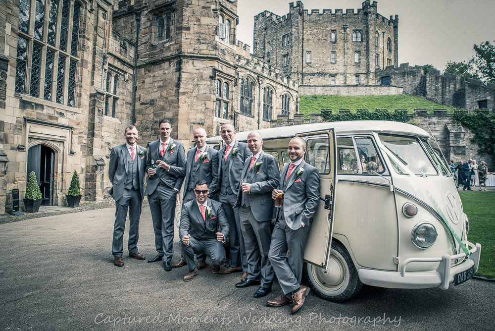 wedding groomsmen beside vw camper van