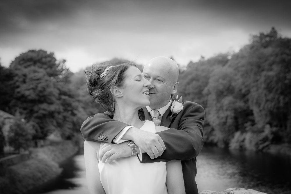 northumberland bride and groom black and white on bridge
