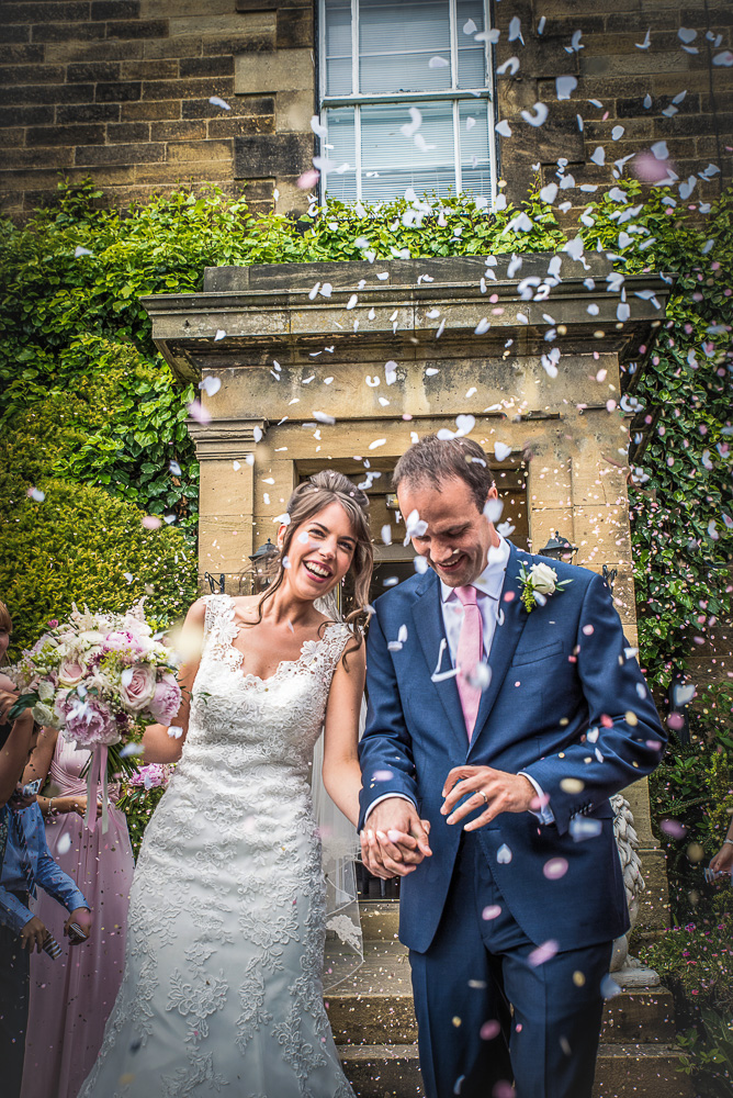 Northumberland wedding bride and groom covered in confetti