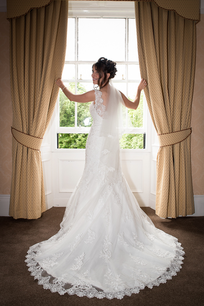 northumberland wedding photography of bride infront of window