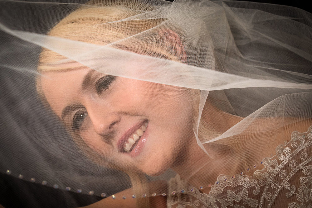 northumberland wedding photography of bride with veil over face