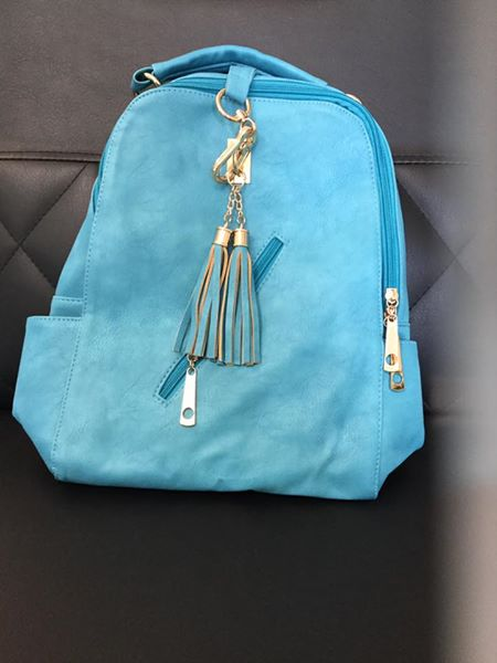 Victoria Leland Backpack - Designer backpack. Comes in the 2 colors shown! Lots of convenient pockets. We have 2 turquoise backpacks and 2 cream colored backpacks left in stock!$45