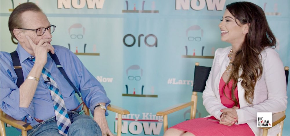 Loureen on set interviewing iconic television and radio host, Larry King.
