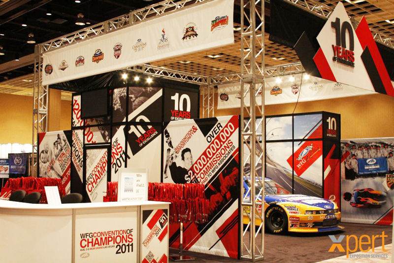 Bright colours, consistent branding and design, and extreme emphasis (race car, anyone?) will make your booth stand out.
