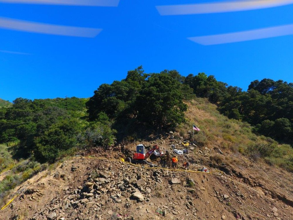 Located 500' above Palomares Road, the spider machinery prepare to descent down the hillside removing the large boulders.