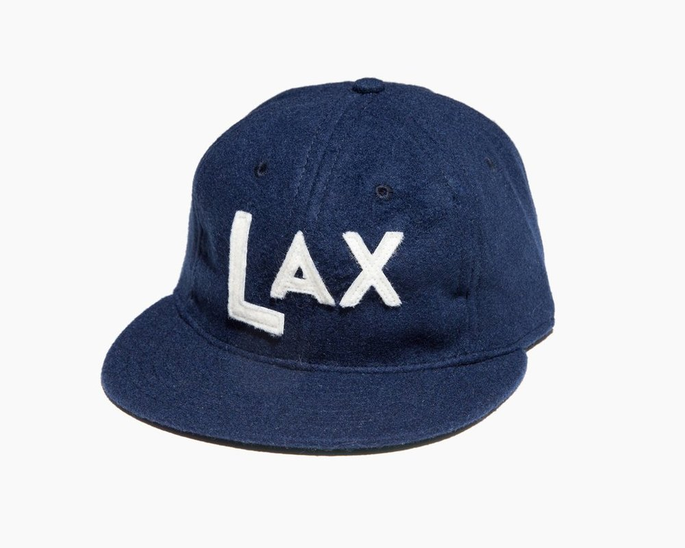 CLAY AND BROS  HAT   This hat hasn't left my side since I left LA. Has a vintage look to it and I love that its Wool. I also love that it represents the LA airport, the perfect hat for travel junkies. (They also represent JFK, ATL, and BNA.)