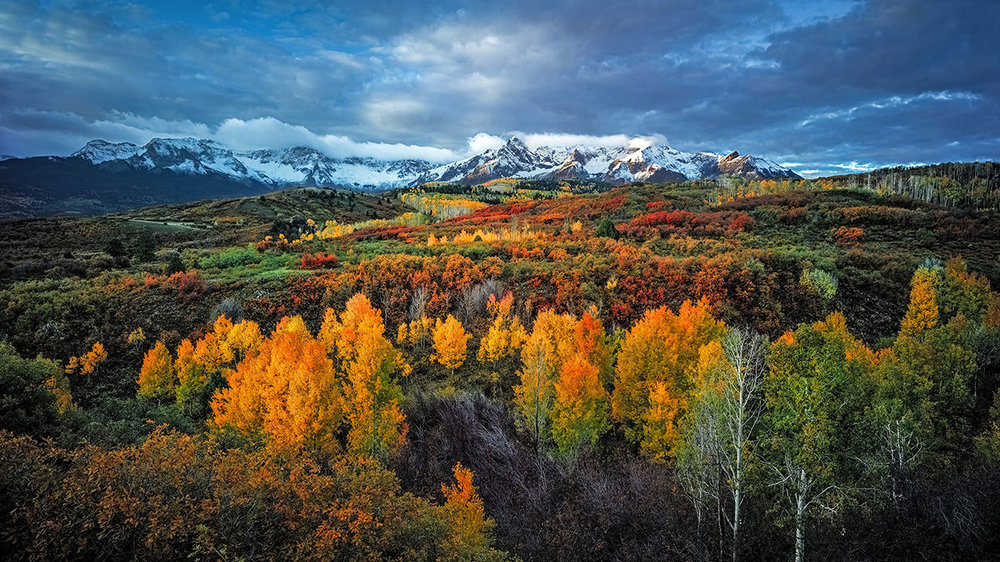 Dallas Divide - For a landscape photographer, the Dallas Divide is one of the greatest of American vistas. The combination of rolling hills, colorful underbrush and golden Aspens serve as a perfect foreground to the grandeur that is the San Juan Mountain range. And during the peak fall season, this location will simply take your breath away.