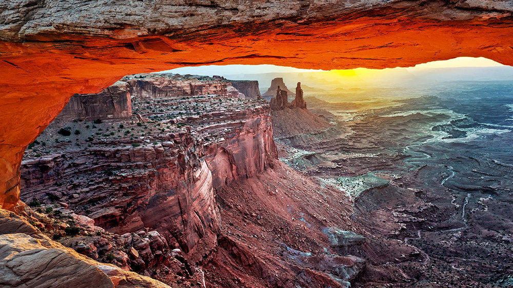 "Mesa Arch - This is the ""crown jewel"" of the Canyonlands National Park and provides a view you will never see anywhere else on earth."
