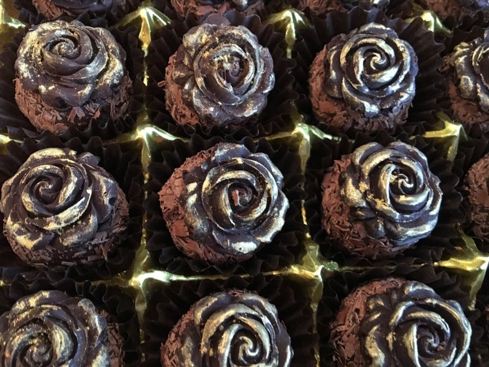 Embellished  Brigadeiro. Chocolate roses with eatable gold dust