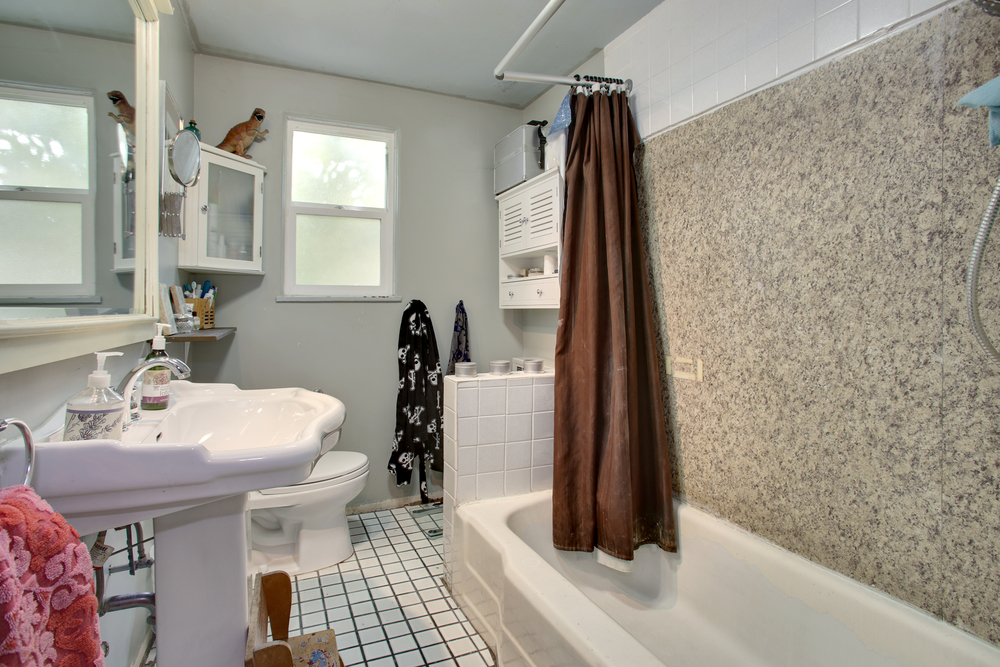 Many of the tiles in both bathrooms need to be repaired or replaced.