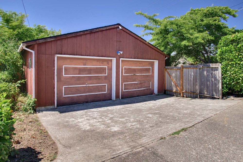 2 car detached garage with off-street parking could be converted to a backyard cottage/music studio with loft sleeping area and rooftop view deck.