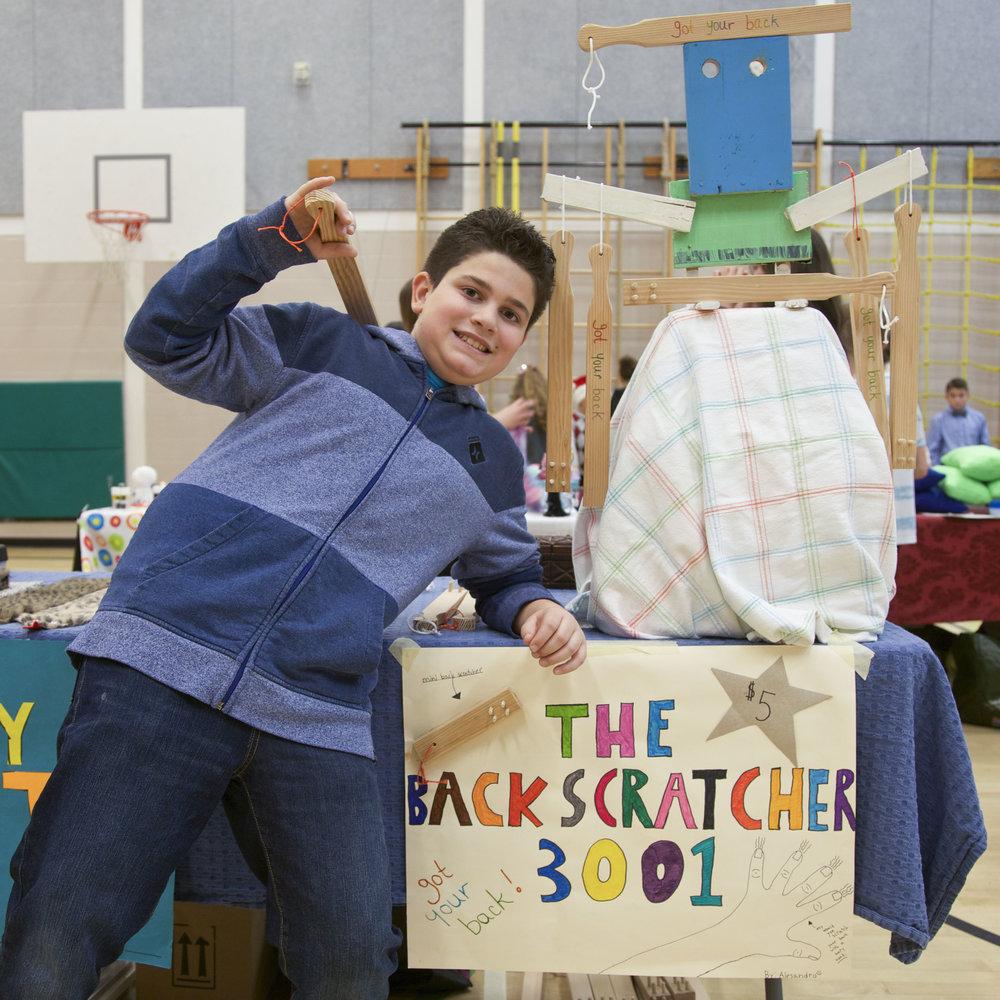 Young entrepreneur unveils his innovative backscratcher product