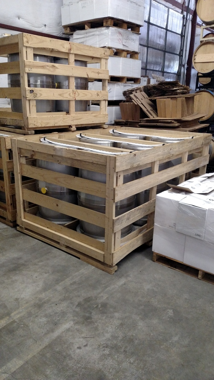 Newly arrived stainless barrels still in their crates