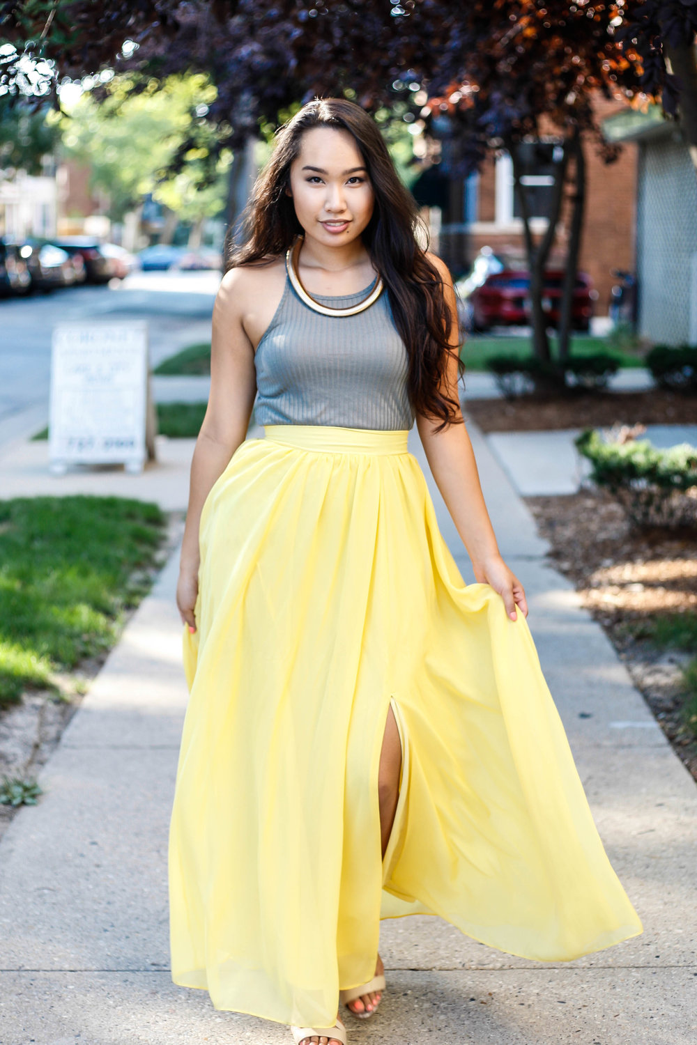 A flowy yellow maxi skirt makes the perfect contrast against the fall leaves.