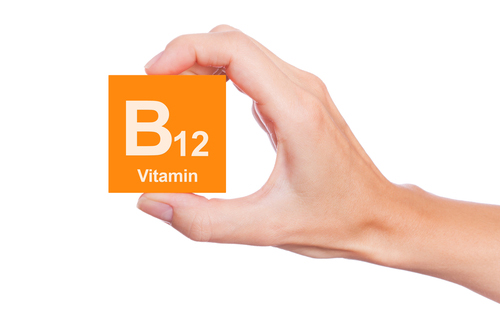 hand-holding-vitamin-B12.jpg