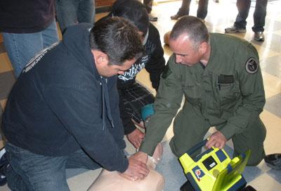 Atilla Uner, M.D., M.P.H. '02 (right), during defibrillator training.