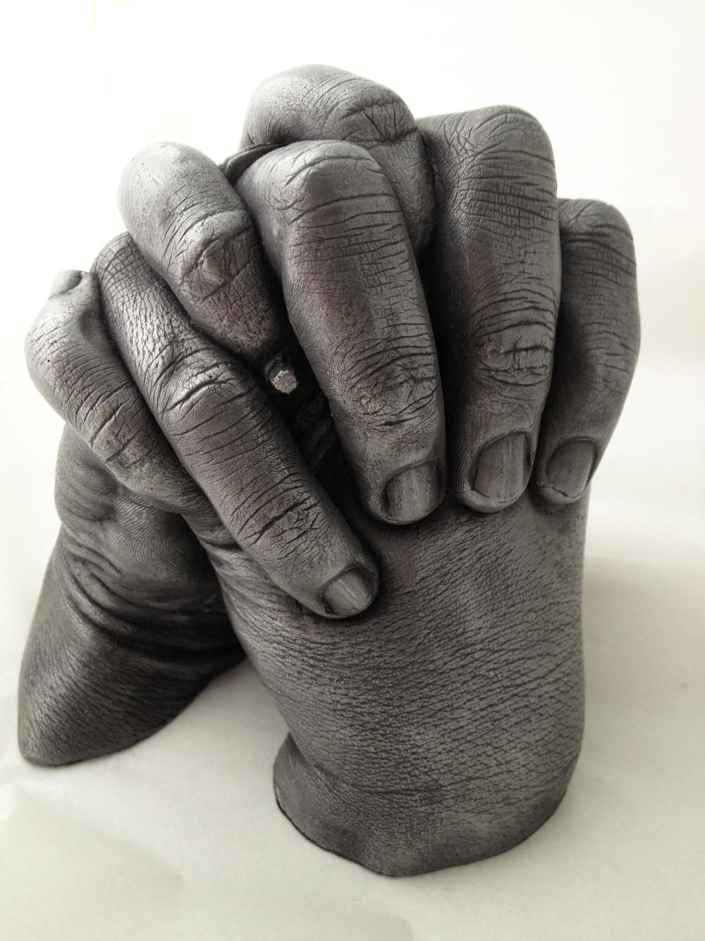 cast aluminium couple hands.jpg