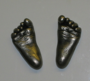 06_Pewter feet fridge magnets.jpg