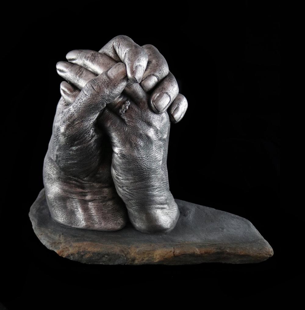 couple hand cast on slate.jpg