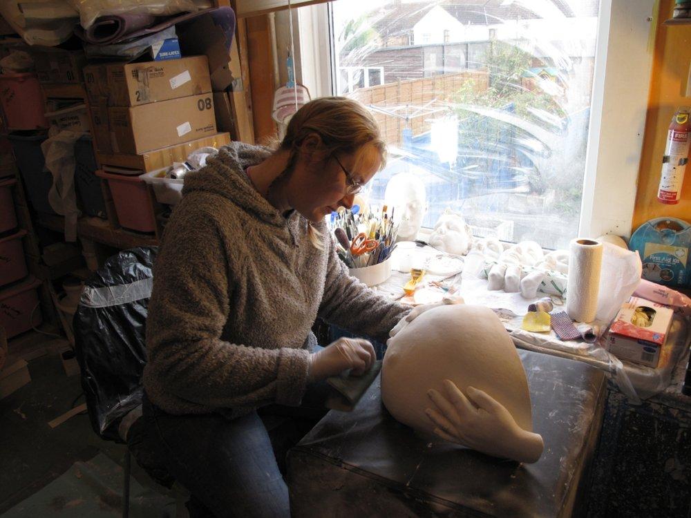 CJ Munn working on a pregnant belly cast