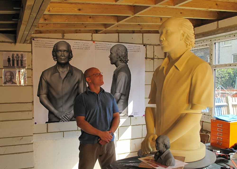 André Masters with large memorial sculpture