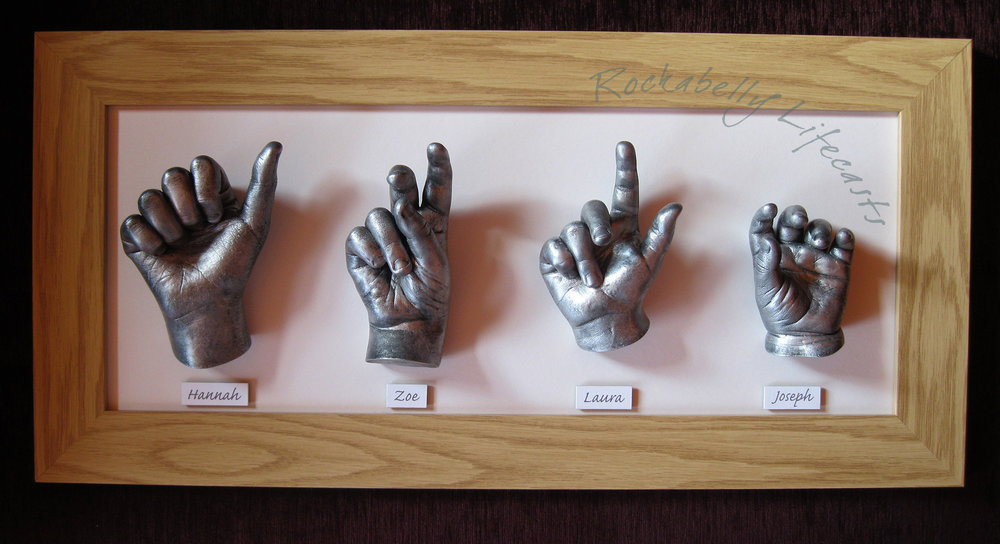 Framed cast hands of four children by Rockabelly Lifecasts