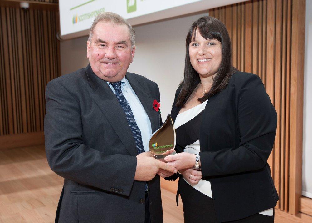 allan galt receiving the customer service award