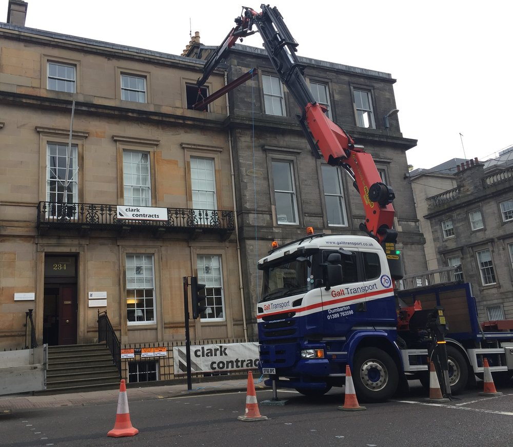 lifting steel beams through a window space in glasgow