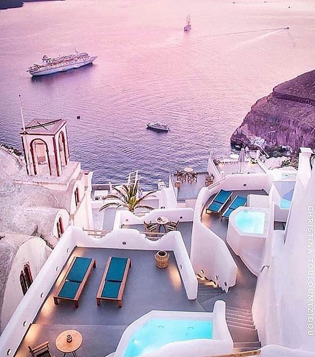 Relaxing in Beautiful Santorini | Tag someone who would love to visit Santorini 👇