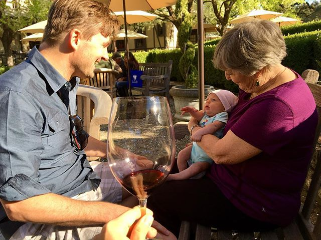 baby's first wine tasting and first visit with grandma mary. she's reaching for the cab!